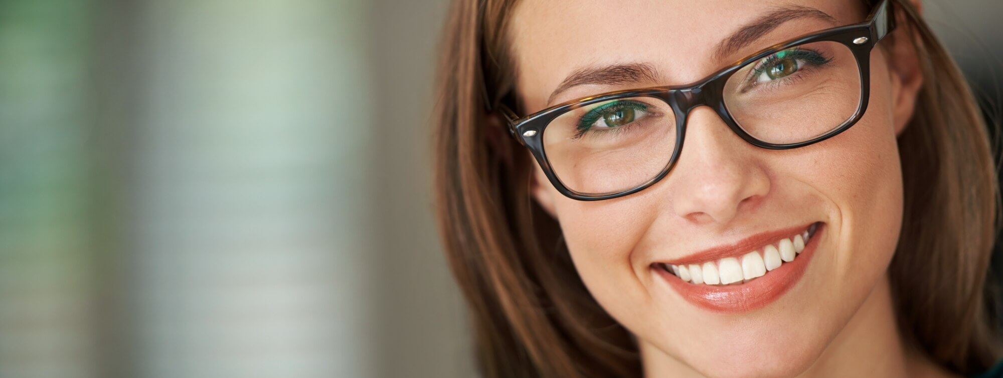 smiling-woman-with-black-frame-glasses